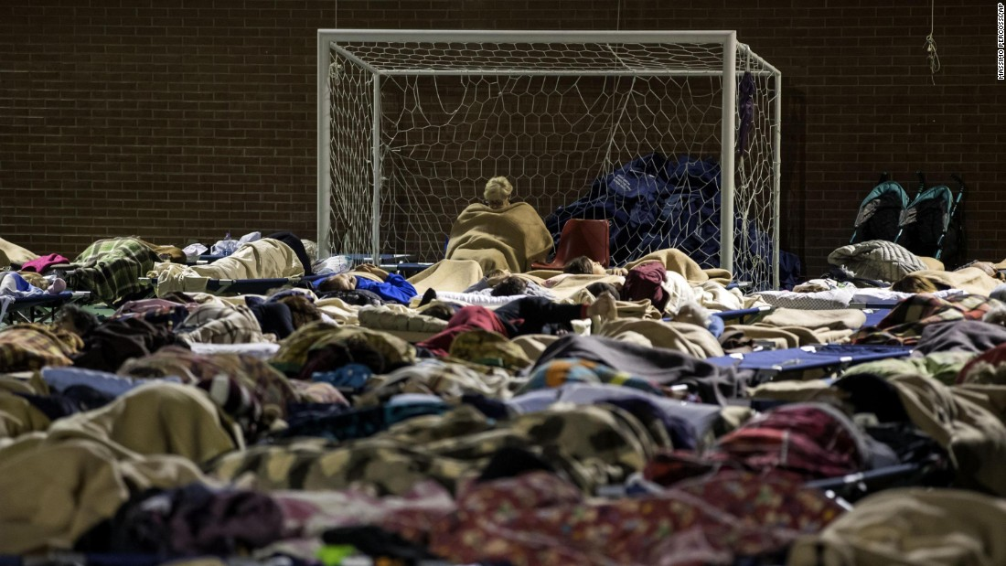 "People rest in a sports center that had been turned into a temporary shelter in Camerino, Italy, on Friday, October 28. More than 15,000 people were housed in temporary shelters after <a href=""http://www.cnn.com/2016/10/31/europe/italy-earthquake/"" target=""_blank"">a powerful earthquake</a> jolted central Italy, a region battered by repeated tremors since August."