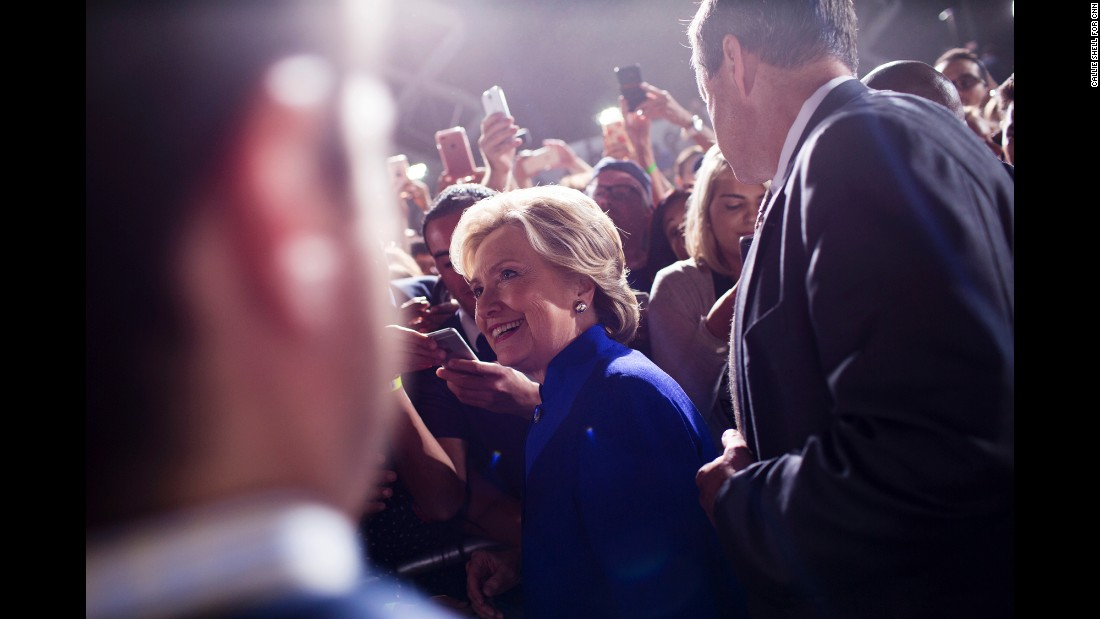 Clinton smiles as she greets supporters in Phoenix on November 2.