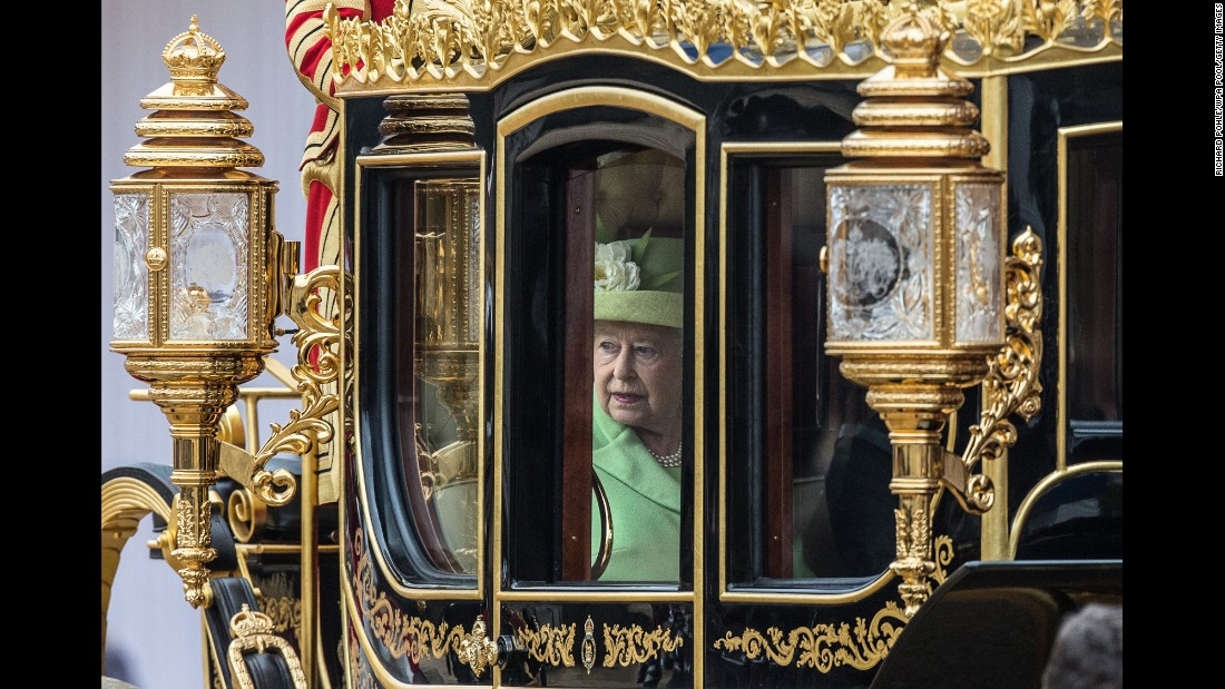 Britain's Queen Elizabeth II travels by coach with Colombian President Juan Manuel Santos, not pictured, after Santos arrived in London on Tuesday, November 1.