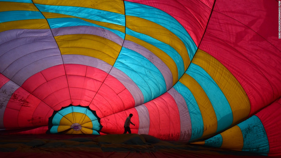 A man in Allahabad, India, prepares to inflate a hot-air balloon on the eve of the Diwali festival on Saturday, October 29.