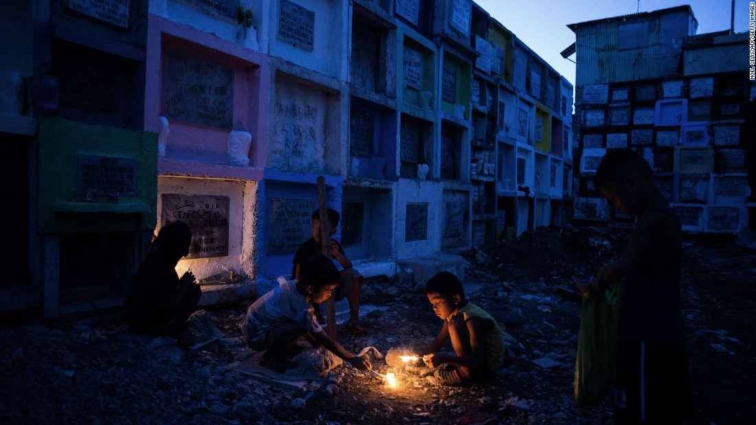 "Children play near tombs at the Navotas Public Cemetery, north of Manila, Philippines, on Sunday, October 30. <a href=""http://www.cnn.com/2016/10/27/world/gallery/week-in-photos-1028/index.html"" target=""_blank"">See last week in 31 photos</a>"