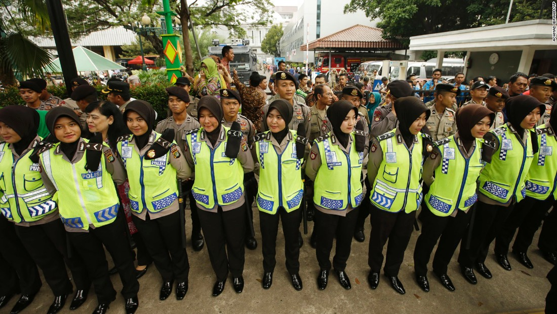 Indonesian policewomen stood guard during the protest outside Jakarta's City Hall on November 4.