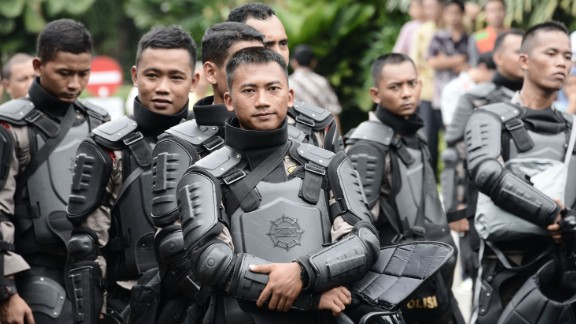 Indonesian riot police were on standby in the compound of the governor
