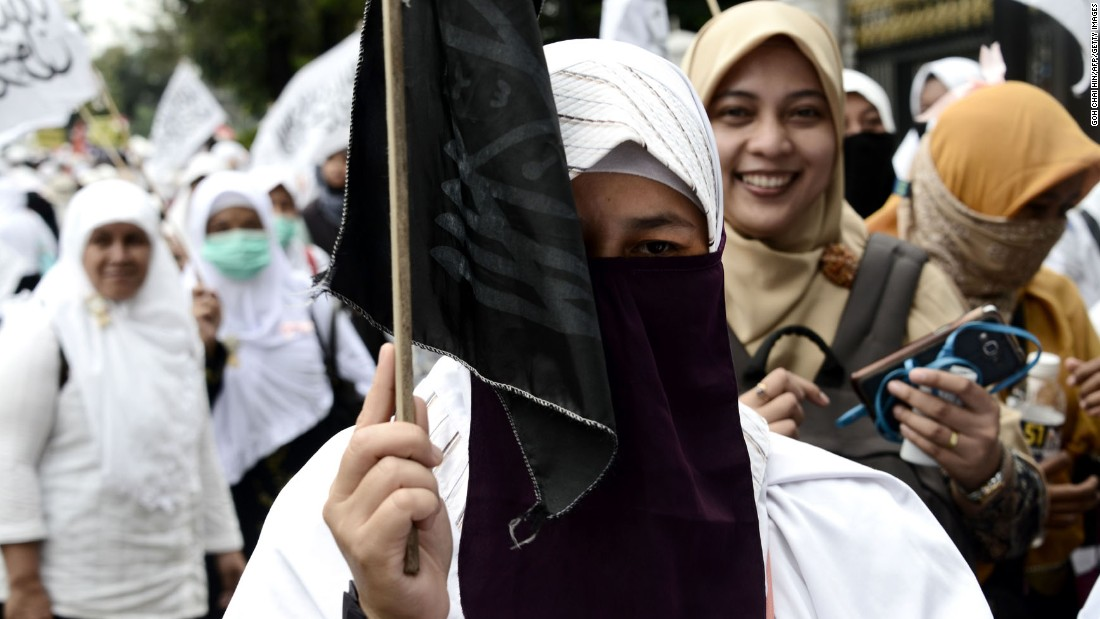 Female Muslim protesters marched outside the governor's office on November 4.