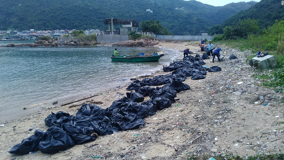 Trash being cleaned up on Sok Ku Wan beach.