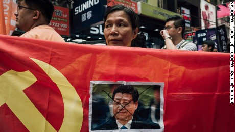 A protester displays a photo of Chinese President Xi Jinping during a rally to support the Hong Kong booksellers.