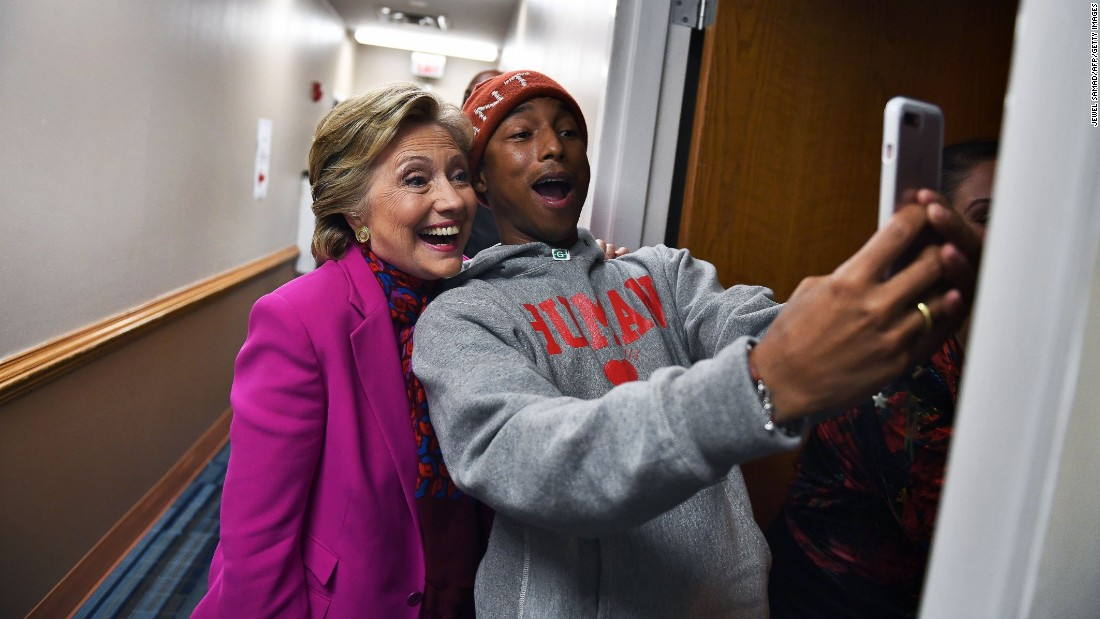 Musician Pharrell Williams takes a selfie with Hillary Clinton before a campaign rally in Raleigh, North Carolina, on Thursday, November 3.