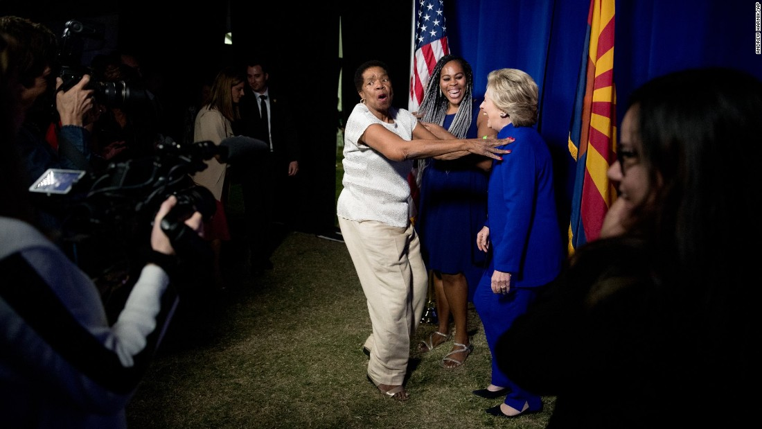 A woman becomes excited as she meets Hillary Clinton for a backstage photo in Tempe, Arizona, on Wednesday, November 2.