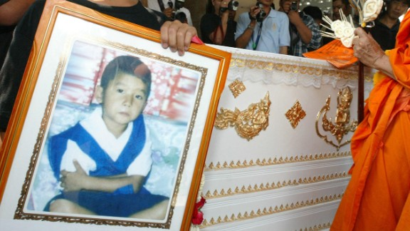Captain Boonmanuch, a young boy who lived in northern Thailand, may have played a small role in the spread of H5N1 avian flu, or bird flu, in 2003. He was the first human death from bird flu in Thailand during the outbreak. Patipahat Boonmanuch, Captain's brother, held a picture of him during his funeral.