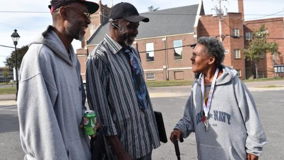 From left, Howard Robinson, Muhamad As-saddique Abdul-Rahman and Katrina Miller speak in the Blackwell neighborhood of Richmond, Virginia, on October 30, 2016.
