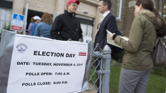 Voters line up to cast their ballots at a polling station in Washington, DC, November 4, 2014, during the midterm elections.  With Senate control on the line, US Democrats hope they don