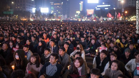 Demonstrators in Seoul call for the president's resignation Saturday.
