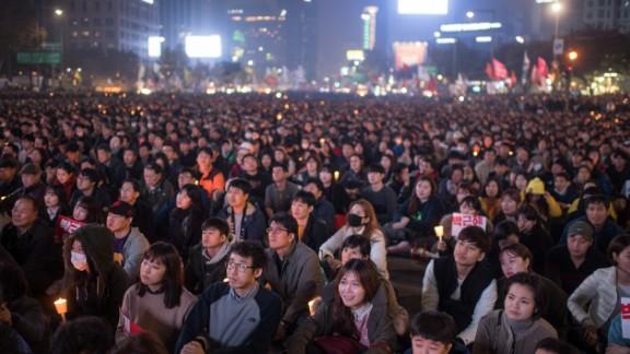 Demonstrators in Seoul call for the president