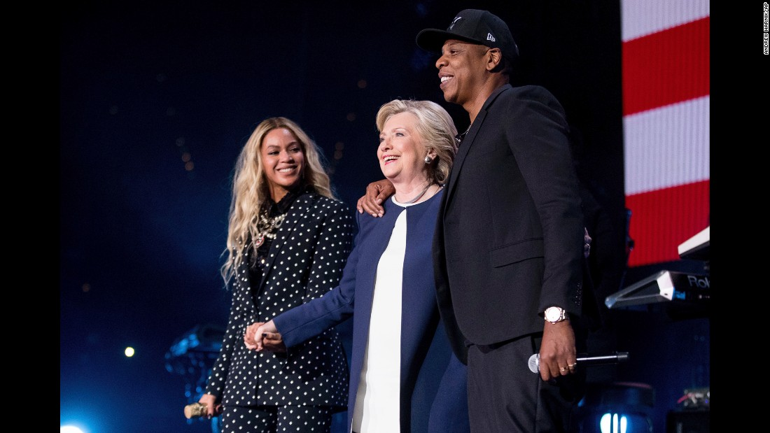 "Democratic presidential candidate Hillary Clinton appears on stage with artists Jay Z, right, and Beyonce, left, during <a href=""http://www.cnn.com/2016/11/04/politics/hillary-clinton-jay-z-beyonce-big-sean-chance-the-rapper/index.html"" target=""_blank"">a free concert </a>Friday, November 4, at at the Wolstein Center in Cleveland."