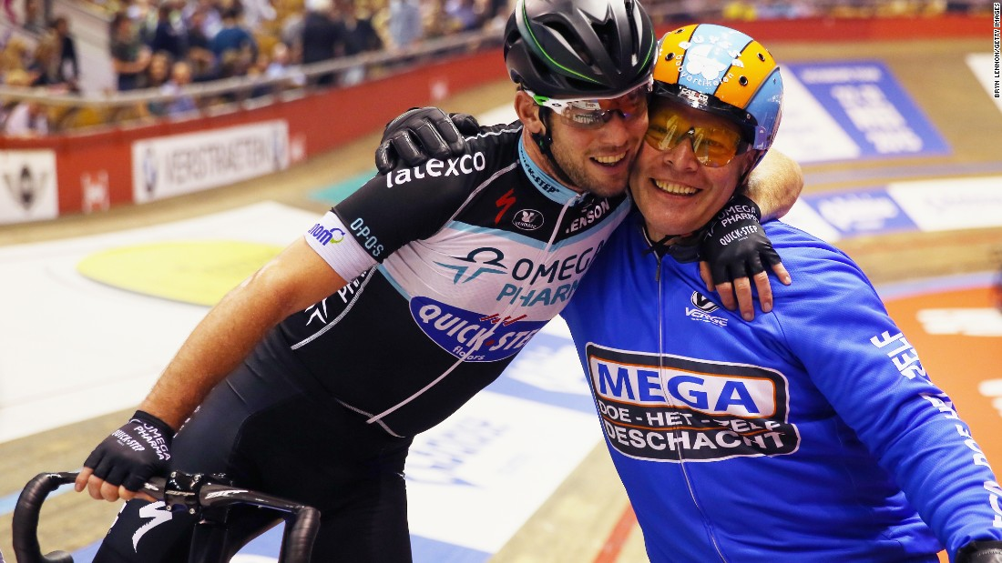 Mark Cavendish of Great Britain celebrates with Derny pacer Michel Vaarten after winning a race at the Ghent Six Day in 2014.