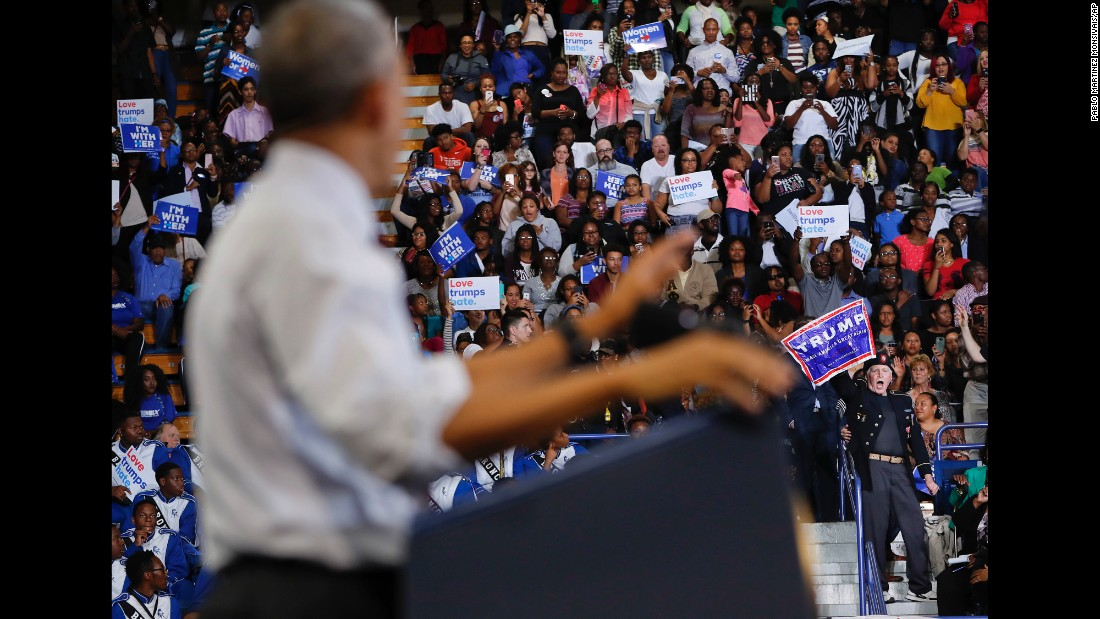 "A supporter of Republican presidential candidate Donald Trump, lower right, <a href=""http://www.cnn.com/videos/politics/2016/11/04/obama-north-carolina-protester-crowd-focus-sot-nr.cnn"" target=""_blank"">interrupts President Barack Obama's speech</a> at Fayetteville State University on Friday, November 4, in Fayetteville, North Carolina, during a campaign rally for Democratic presidential candidate Hillary Clinton."