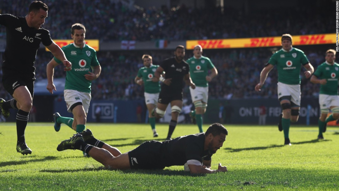 George Moala dives over to score the opening try for the All Blacks at Soldier Field.