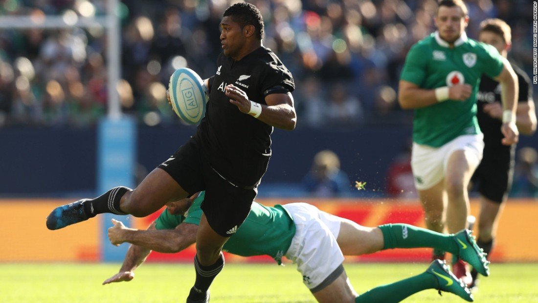Waisake Naholo of New Zealand evades a tackle from Simon Zebo before setting up the opening try for his team.
