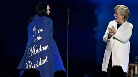 "Singer Katy Perry shows off a coat reading ""I'm With Madam President"" during a Clinton event in Philadelphia on November 5."