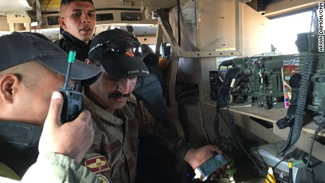 "For more than 28 hours, CNN senior international correspondent Arwa Damon and photojournalist Brice Laine were with Iraqi special forces during their push into ISIS-held Mosul. Their convoy was leading the operation Friday when it came under attack multiple times. Here, on Friday at 9 a.m., soldiers make a frantic radio call: ""Yellow car to the right."""
