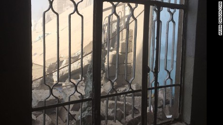 Rubble is seen through a window. An airstrike took out the house behind the one in which Arwa and Brice were staying.