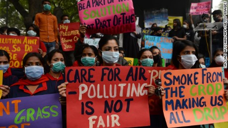 Indian protesters wearing protective masks urge action to curb air pollution in New Delhi on Sunday.