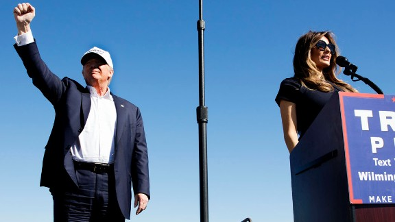 Trump and his wife, Melania, arrive at an airport rally in Wilmington, North Carolina, on November 5.