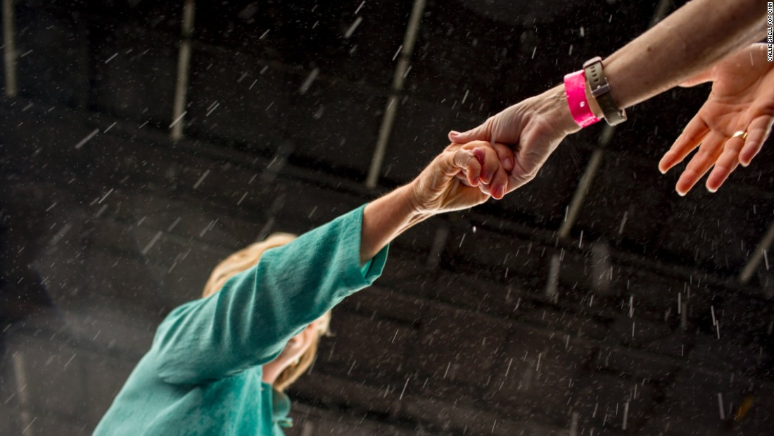 Clinton shakes hands with supporters during a rainstorm in Miami on Saturday, November 5.