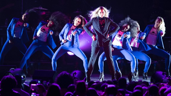 Beyonce and her dancers adopt Hillary Clinton's signature pantsuit at a campaign rally on November 4.