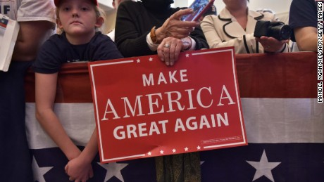 Supporters hold placards during a rally for US Republican presidential nominee Donald Trump at the Atkinson Country Club in Atkinson, New Hampshire on November 4, 2016. / AFP / MANDEL NGAN        (Photo credit should read MANDEL NGAN/AFP/Getty Images)