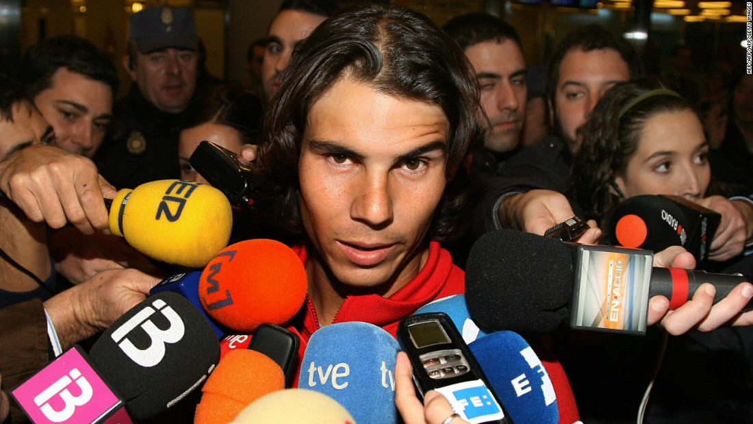 Negotiating your exit from international airports can be a tricky business ... Rafael Nadal is immediately bombarded by the press after touching down at Mallorca as the newly-crowned Australian Open champion in 2009.