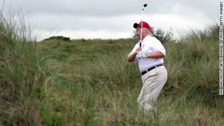 ABERDEEN, SCOTLAND - JULY 10:  Donald Trump plays a round of golf after the opening of The Trump International Golf Links Course on July 10, 2012 in Balmedie, Scotland. The controversial ?100m course opens to the public on Sunday July 15. Further plans to build hotels and homes on the site have been put on hold until a decision has been made on the building of an offshore windfarm nearby. (Photo by Ian MacNicol/Getty Images)