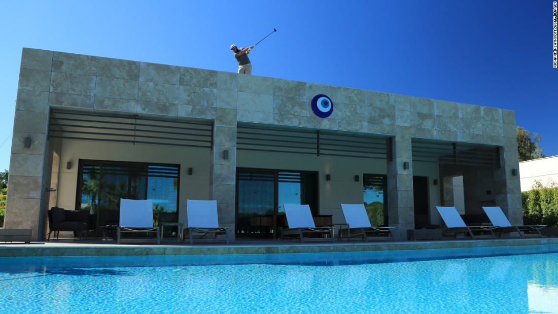 "Andrew Johnson hits a shot from the 16th tee -- <a href=""http://www.golf.com/tour-and-news/european-tour-debuts-villa-rooftop-tee-box-turkey"" target=""_blank"">which happened to be on top of a villa</a> in Antalya, Turkey -- during a practice round for the Turkish Airlines Open on Wednesday, November 2."