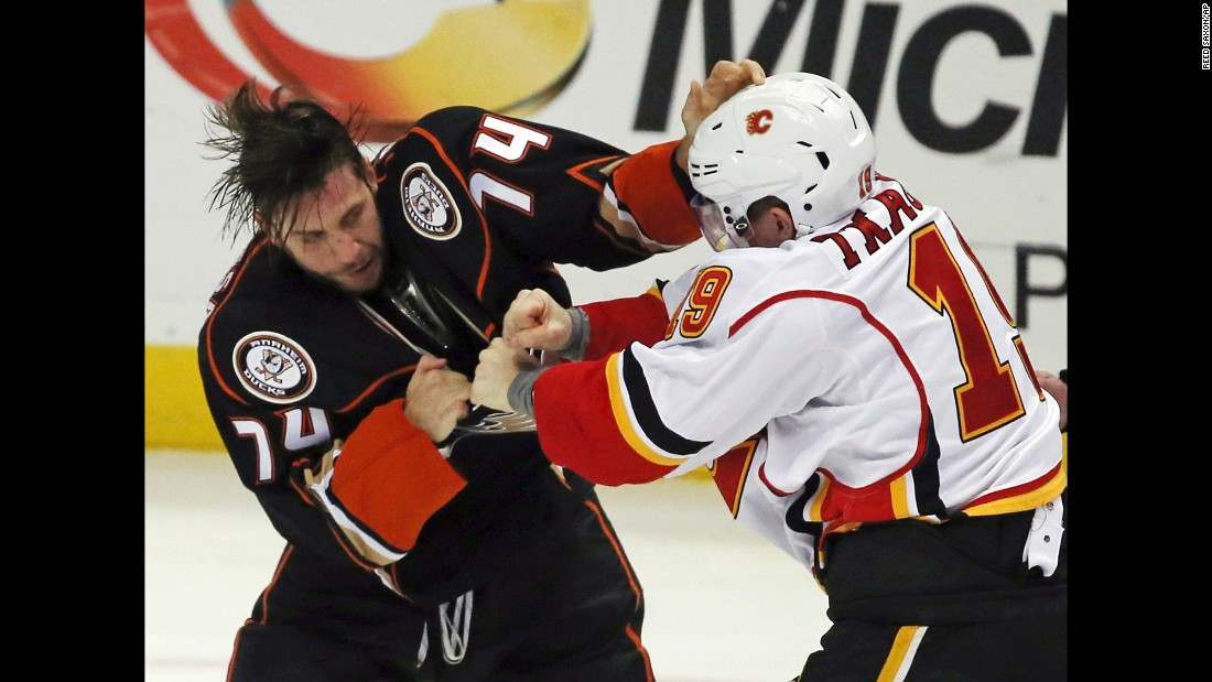 Anaheim's Joseph Cramarossa, left, and Calgary's Matthew Tkachuk fight during an NHL game in Anaheim, California, on Sunday, November 6.