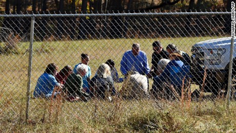 Local church members pray on Kohlhepp's property in Woodruff Monday.