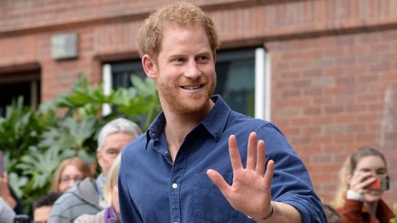 NOTTINGHAM, ENGLAND -  OCTOBER 26: Prince Harry waves as he leaves Nottingham