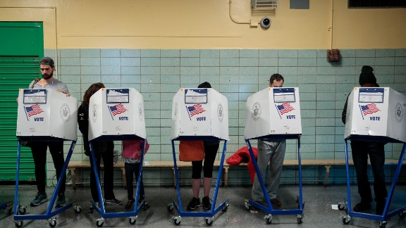 NEW YORK, NY - NOVEMBER 8: People vote at a polling site at Public School 261, November 8, 2016 in New York City. Citizens of the United States will choose between Republican presidential candidate Donald Trump and Democratic presidential candidate Hillary Clinton. (Photo by Drew Angerer/Getty Images)