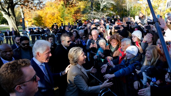 Democratic presidential nominee Hillary Clinton and her husband, former U.S. President Bill Clinton, greet supporters after voting in Chappaqua, New York.