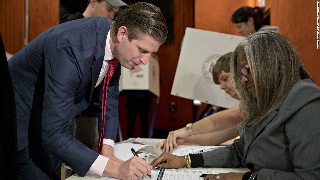 Trump's son Eric signs in to vote at the 53rd Street Library in New York.