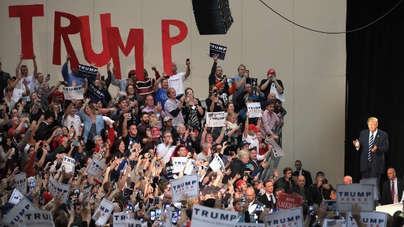 Republican presidential nominee Donald Trump arrives at a campaign rally on November 8, 2016, in Grand Rapids, Michigan.
