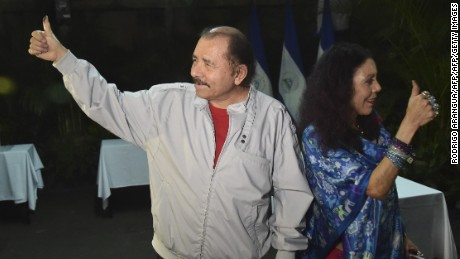 Nicaraguan President Daniel Ortega (L) and his wife Rosario Murillo give their thumbs up after voting in Managua during the presidential election on November 6, 2016.  Nicaragua's President Daniel Ortega and his wife, Rosario Murillo, looked likely to win elections that would hand him a third straight term and cement her role as co-ruler. / AFP / RODRIGO ARANGUA        (Photo credit should read RODRIGO ARANGUA/AFP/Getty Images)