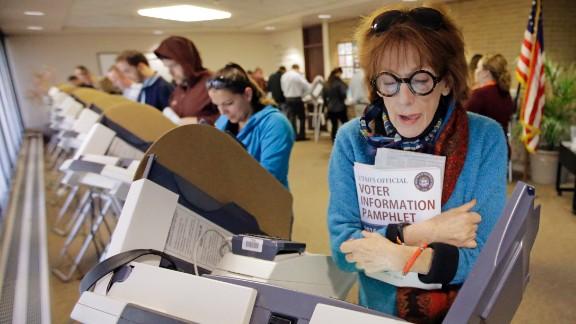 Kathleen Lundy eyes her ballot in Salt Lake City.