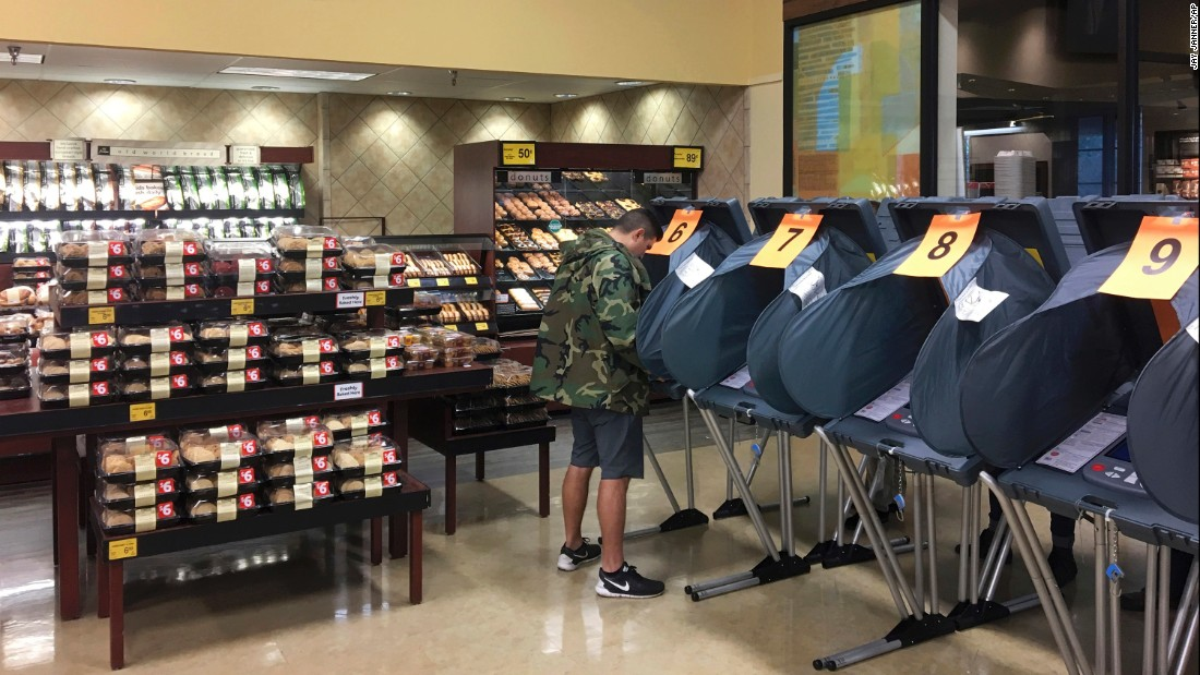 A man votes in the bakery department of an Austin, Texas, grocery store.