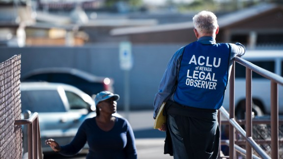A legal observer with the American Civil Liberties Union of Nevada stands at the entrance of a polling location in North Las Vegas.