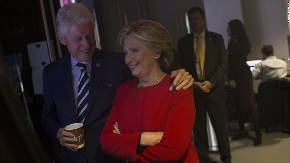 The Clintons share a moment backstage.