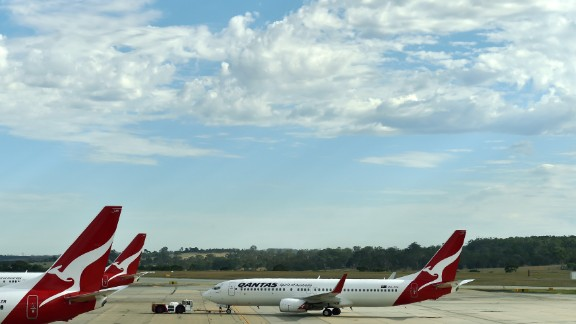 A Qantas plane leaves a departure gate at Melbourne Airport, in 2015.