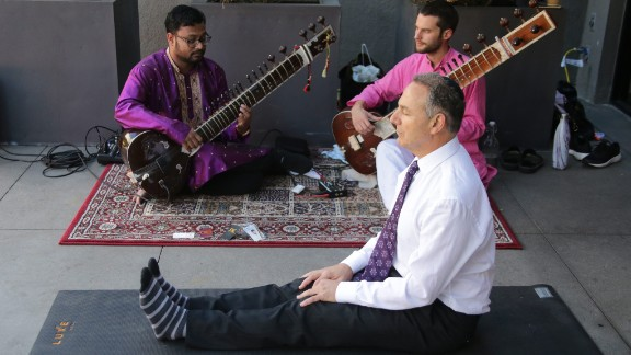 With sitar players performing next to him, Efrem Harkham meditates after voting at the Luxe Hotel polling station in Los Angeles.
