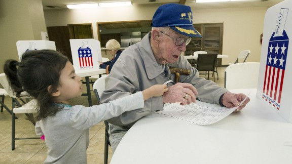 "Harvey Erwin, a 94-year-old World War II veteran, votes with his 3-year old great-granddaughter in Joplin, Missouri. Fellow voters applauded Erwin as he walked to the front of the voting line. ""People turned and started clapping all the way to the front of line and saying 'Thank you for your service,' "" his daughter, Janine Erwin Johnson, told CNN. ""It made tears stream down my face because of the recognition to my sweet dad."""