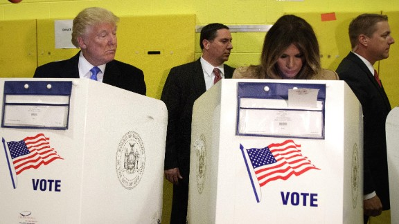 Republican presidential nominee Donald Trump looks at his wife, Melania, as they cast their votes in New York.