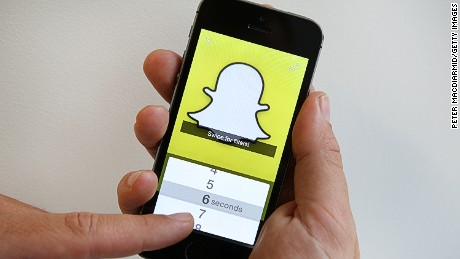 LONDON, ENGLAND - OCTOBER 06:  In this photo illustration the Snapchat app is used on an iPhone on October 6, 2014 in London, England. Snapchat allows users' messages to vanish after seconds. It is being reported that Yahoo may invest millions of dollars in the start up firm.  (Photo by Peter Macdiarmid/Getty Images)